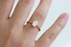 Oval Diamond Engagement Ring on finger