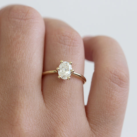Oval Diamond Engagement Ring on hand