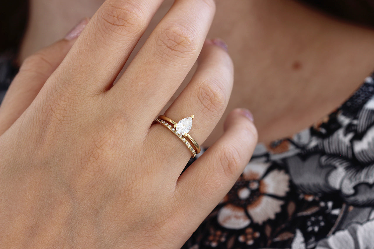 Minimalist Engagement Ring On Hand