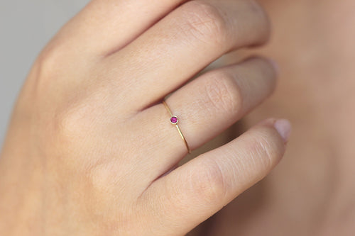 thin gold ruby ring on hand