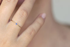 thin gold sapphire ring oh hand