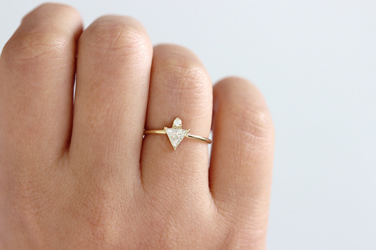 triangle engagement ring on hand