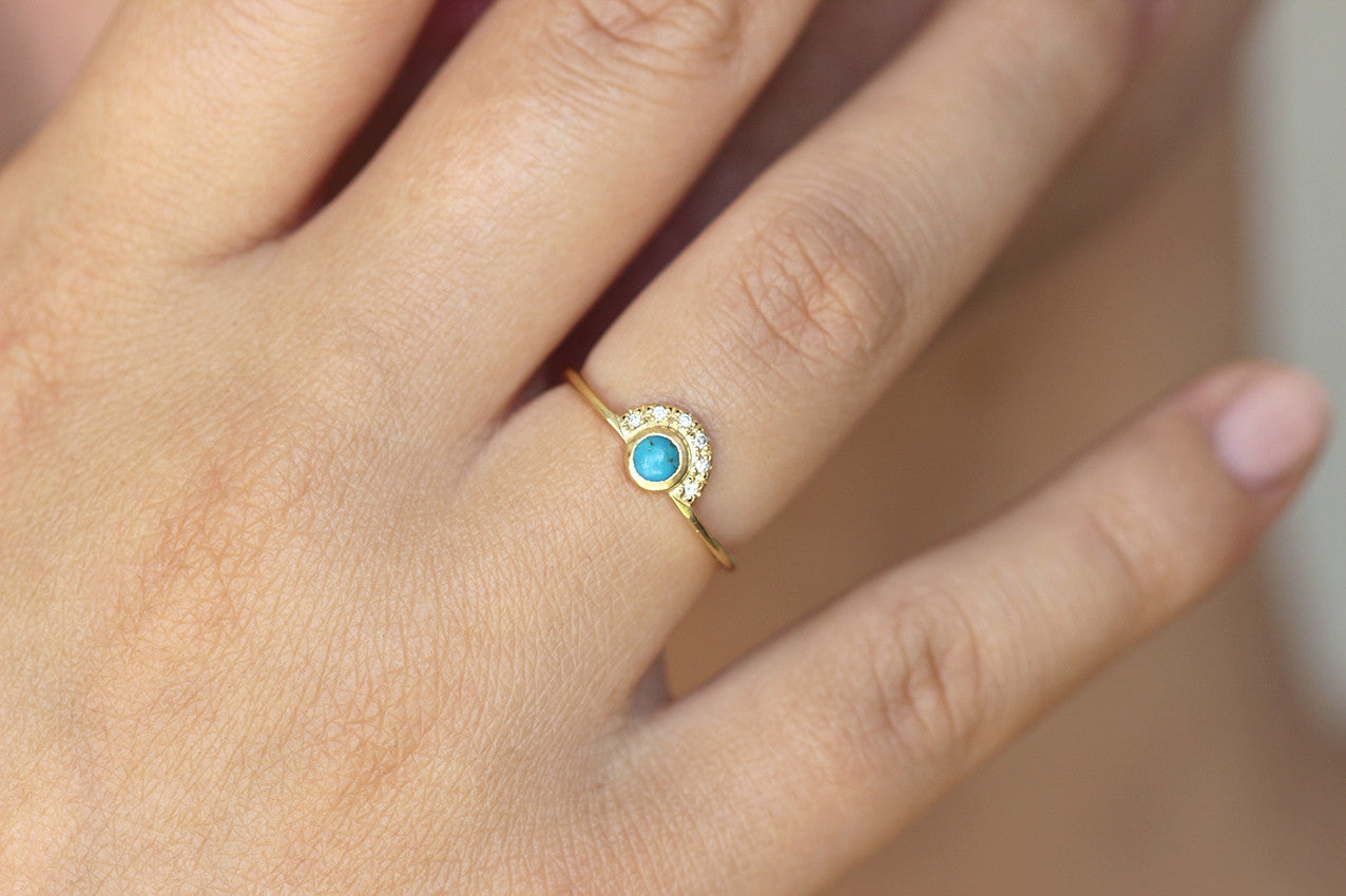 turquoise engagement ring on hand