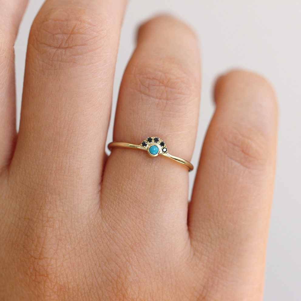 Delicate Turquoise Band on finger