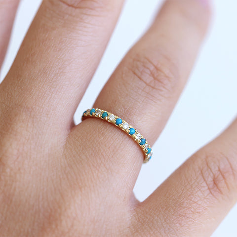 Turquoise Wedding Ring with Diamonds on Finger