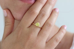 yellow sapphire engagement ring on finger