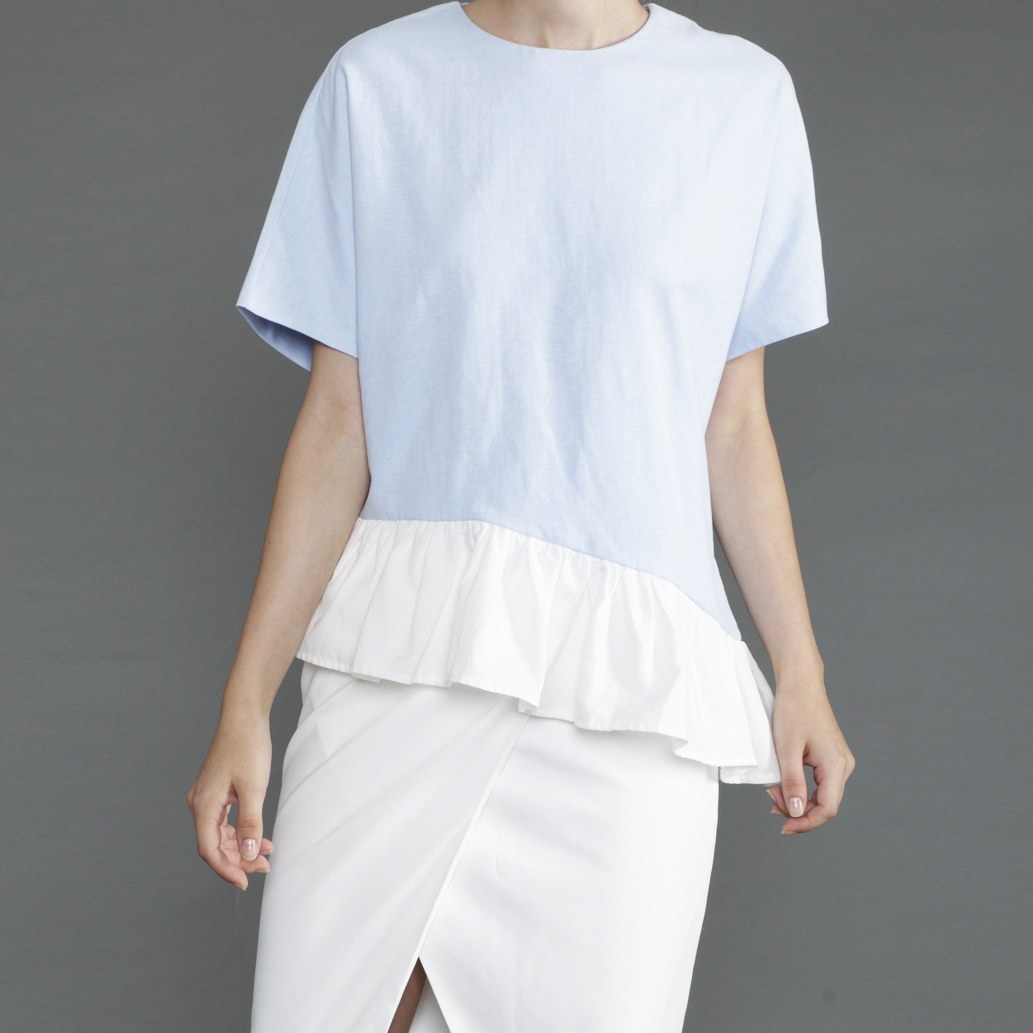 ASYMMETRICAL RUFFLED HEM TOP