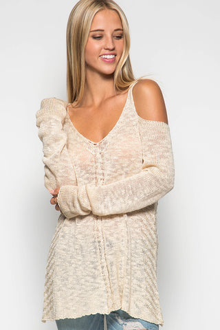 Cotton knit sweater in champagne with open shoulders and long sleeves.