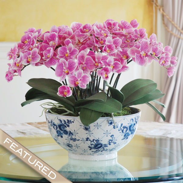 Eclectic phalaenopsis orchid centerpiece winward home