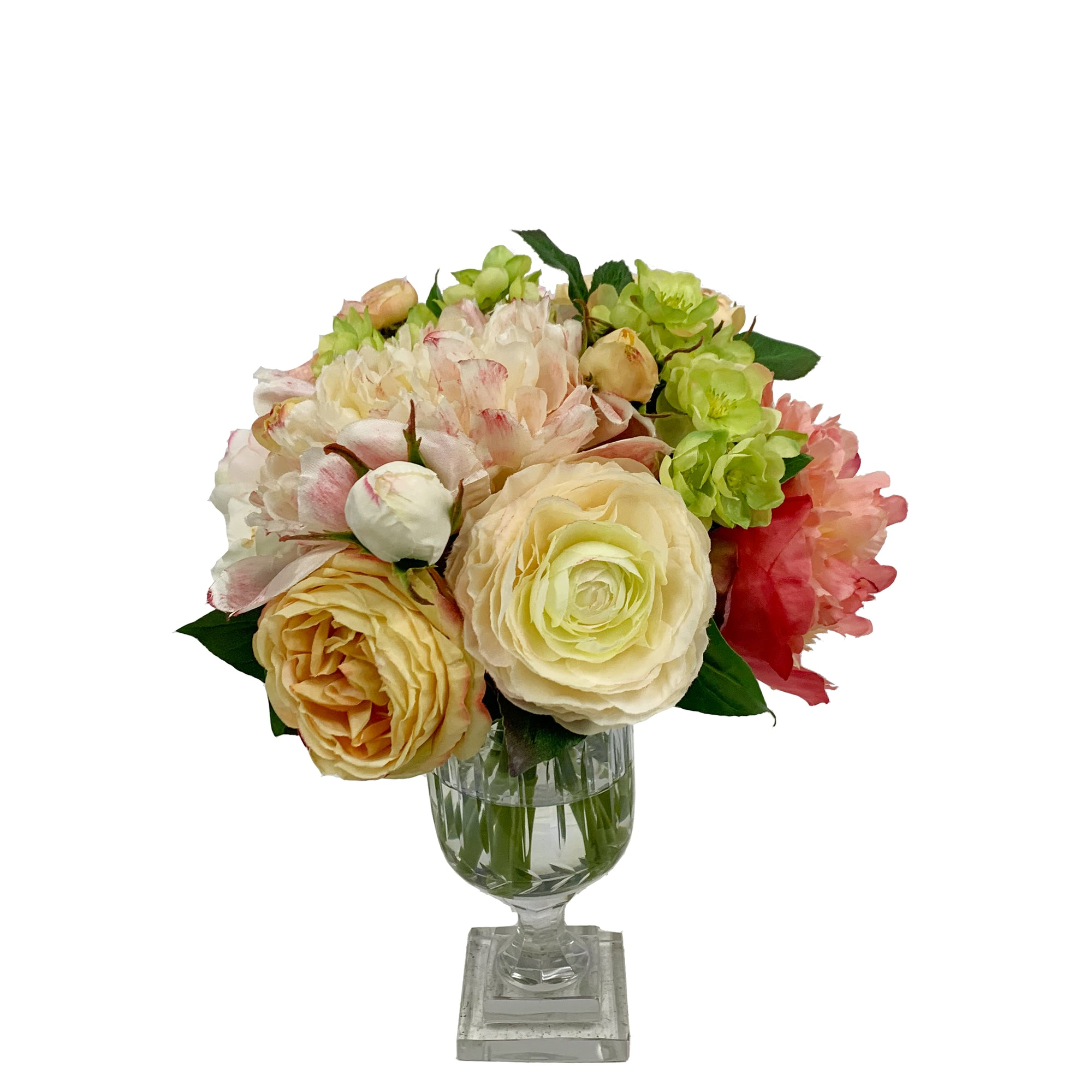 Mixed roses and peonies in clear glass urn
