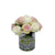 Artificial mixed colored rose bouquet in glass vase