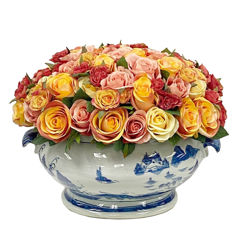 mixed color roses in white and blue ceramic container