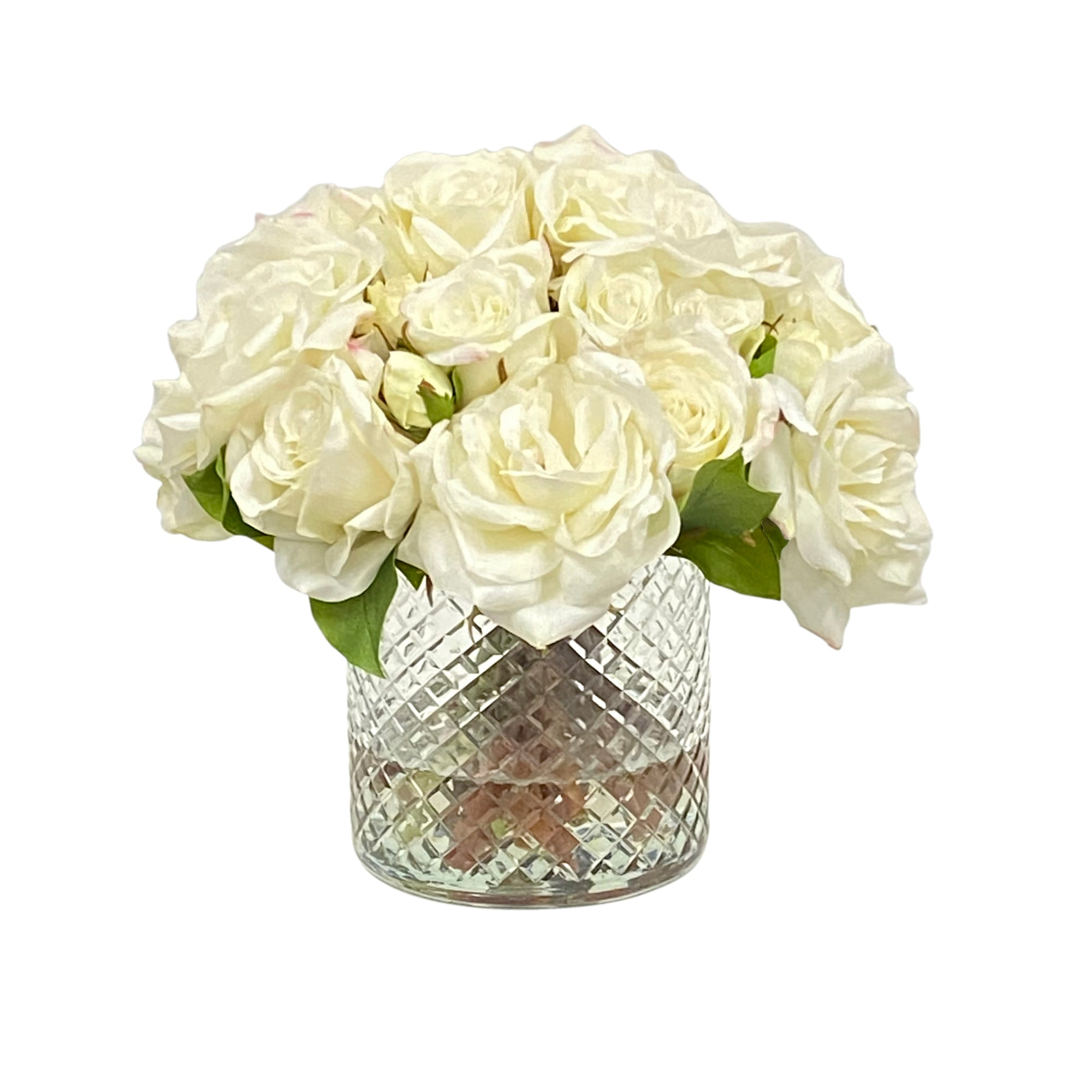 White roses in diamond cut glass vase