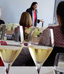 Maggie Henriquez Speaking with Krug Champagne Glasses in the Foreground
