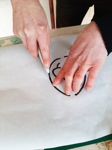 Cutting out a stencil for screen printing
