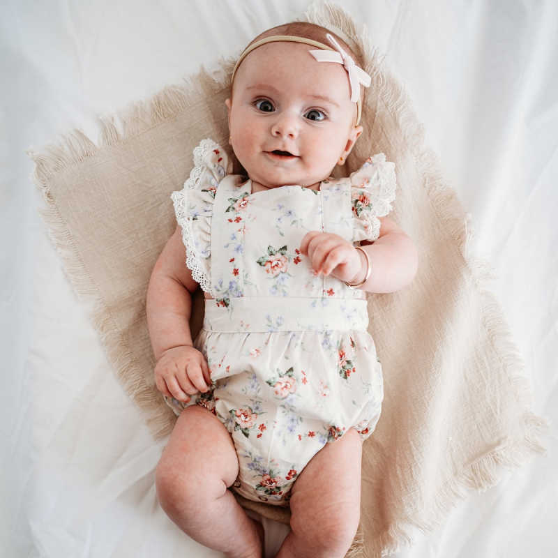 Baby Girl wearing a Cream Floral Lace Baby Romper