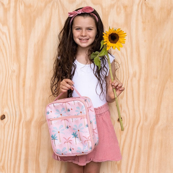 Girl holding MontiiCo Boho Palms Lunchbag and Sunflower
