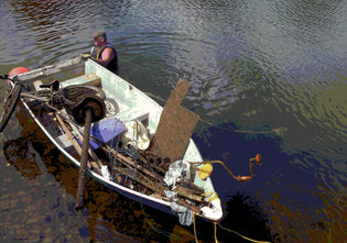 doug-snedden-with-a-boat-full-of-waste