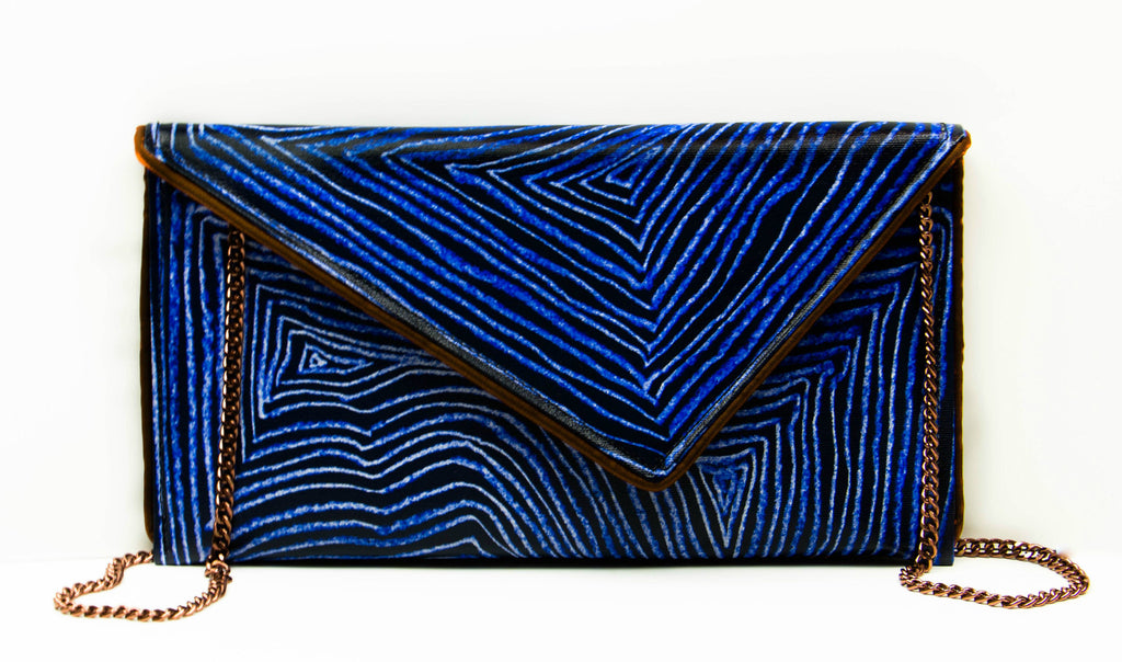 Canvas clutch purse handmade by Kent Stetson, perfect for those who appreciate bold personal touch to their wardrobe.