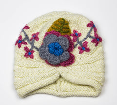 100% Acrylic wool knitted touque by Peruvian Trading Co., keep warm this winter while being fashionable.