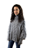 100% acrylic wool cable knitted poncho by Peruvian Trading Co., perfect to be fashion forward and warm this season.