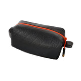 100% up-cycled toiletries bag by Alchemy Goods with orange zipper and lining for easy clean up