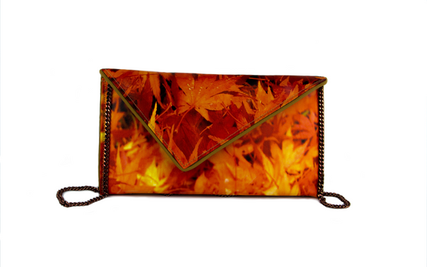 canvas clutch bag by Kent Stetson, make a bold statement while looking elegant.