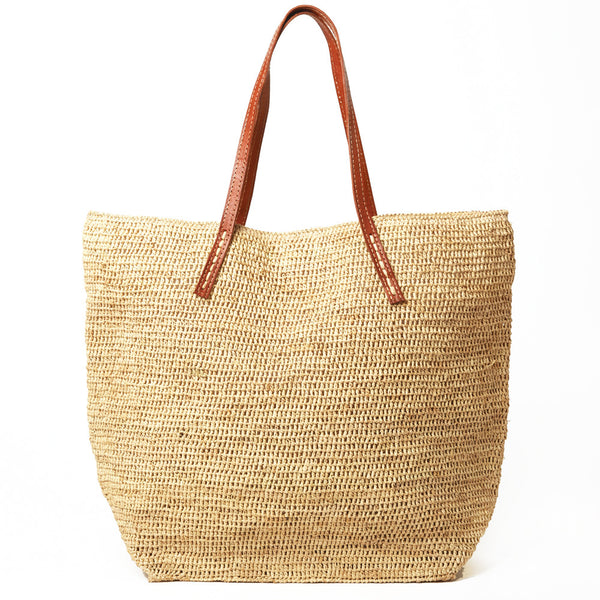 Raffia and Leather tote bag by Mar Y Sol, the prefect way to carry your beach gear all year 'round!