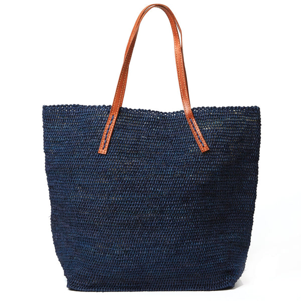 Raffia and Leather tote bag by Mar Y Sol, a timeless way to carry your items all year 'round.