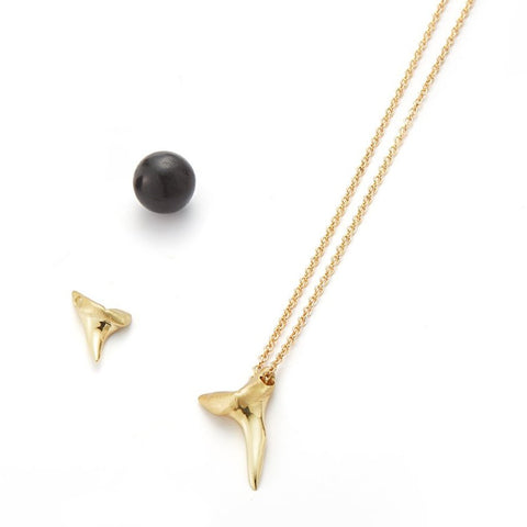 men's and women's solid gold shark tooth pendant on cotton cord by finn by candice pool neistat