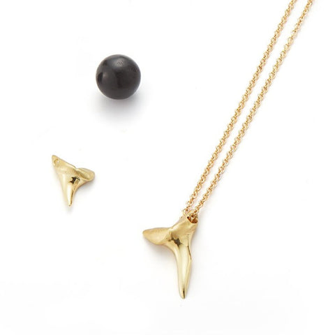 medium gold shark tooth in 18k gold long chain necklace summer jewelry by finn by candice pool neistat
