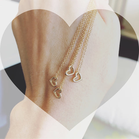dainty mini heart 18k gold necklace on long chain by finn by candice pool neistat perfect for Valentines Day