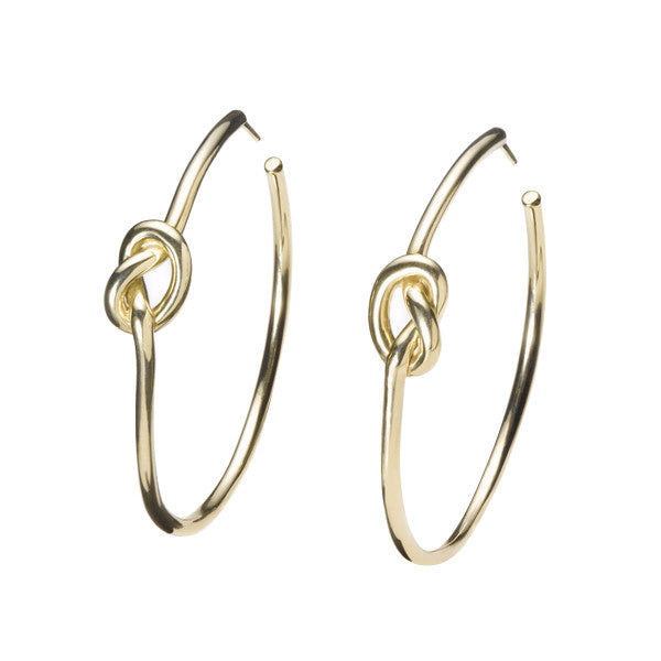 simple solid 18k gold love knot hoop earrings by finn by candice pool neistat perfect for Valentines Day