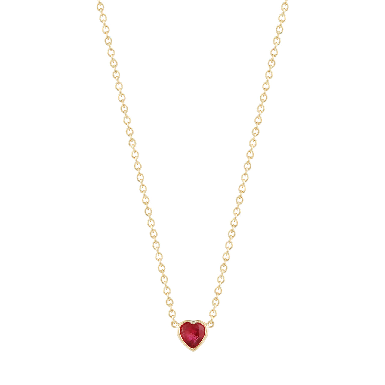 adorable and cute heart shaped red ruby on mid length 18k yellow gold chain by finn by candice pool neistat