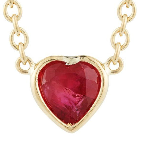adorable and cute heart shaped red ruby on mid length 18k yellow gold chain by finn by candice pool neistat perfect for Valentines Day