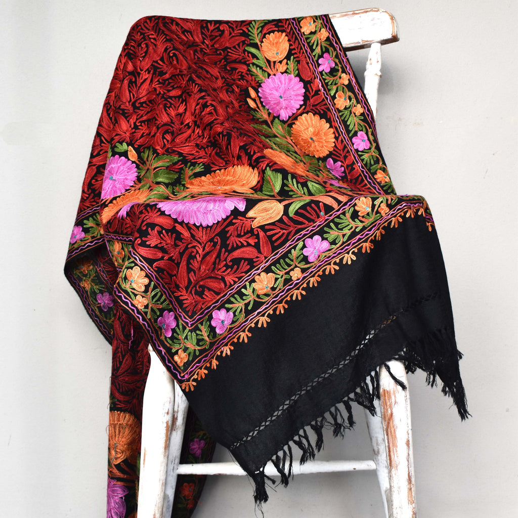 woollen floral scarf draped on a chair