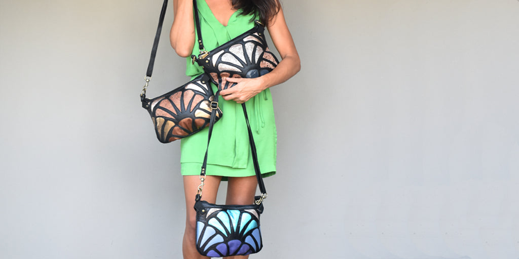 Woman wearing a green dress and leather bags