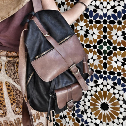 leather backpack against Moroccan tiles