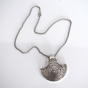 Traditional Tibetan silver pendant with intricate detailing - Mandara bags