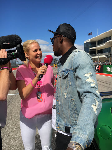 Rosanna Tennant interviews celebrities at the F1