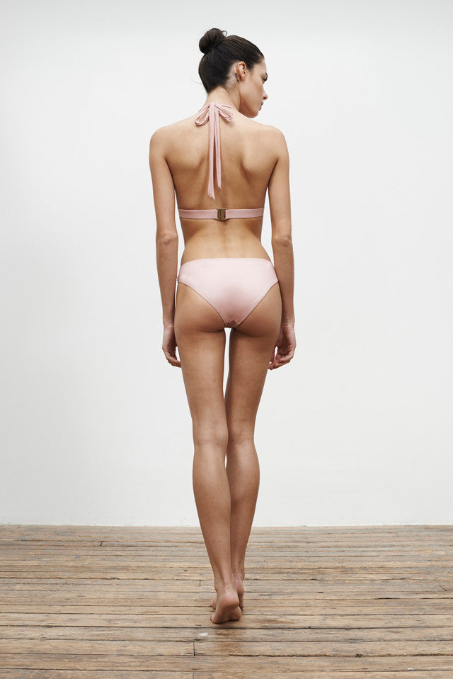 halterneck bikini top and low-rise bikini bottoms, reversible in a dusty rose colour, back view on model
