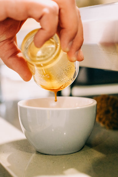 Picture of an espresso shot being poured into a mug.