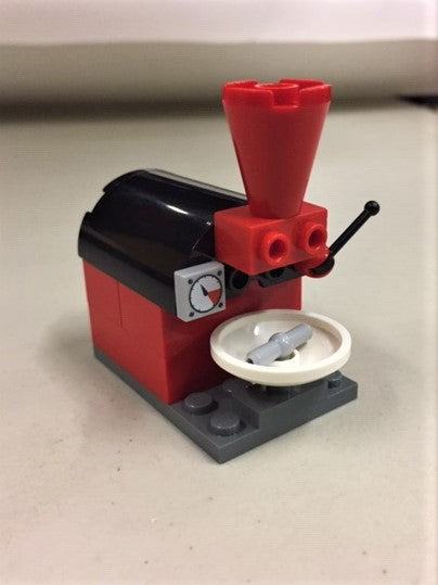 Photo of red and black lego coffee roaster.