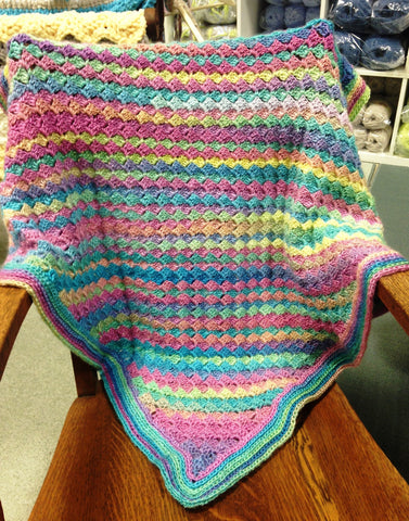 corner to corner crochet blanket made with candied