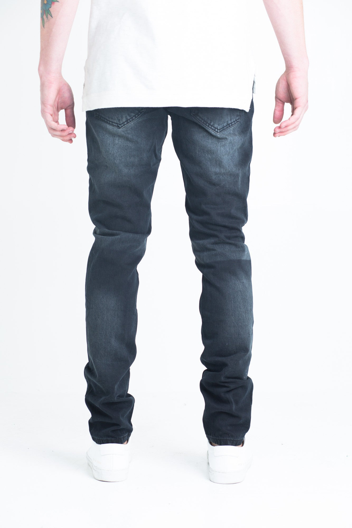 "Edna Ripped Denim | Faded black denim Distressed rips on front Subtle color block wash 2 front zipper pockets 100% cotton Skinny fit 34"" standard inseam"