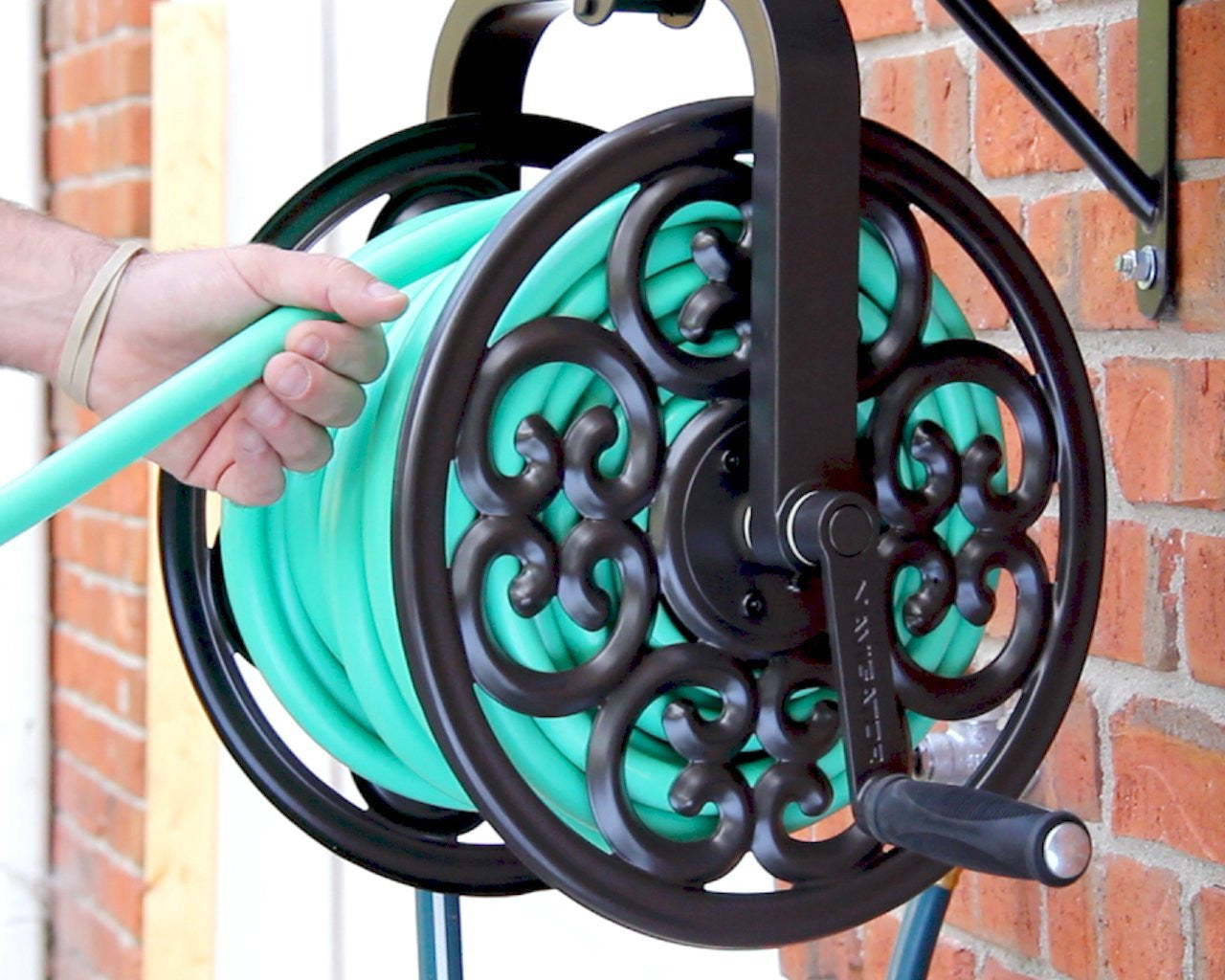 Decorative Swiveling Garden Hose Reel adds Beauty and Function