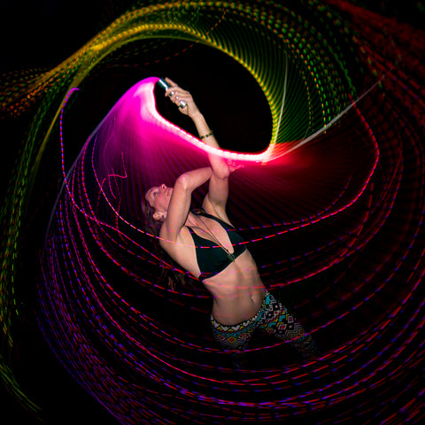 Pixelwhipping dancer with two FiberFlies light up whips