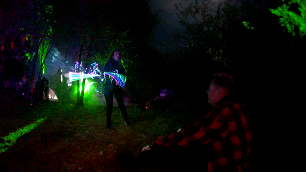 Jasmine giving a light show to an audience at the Crash Site stage