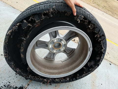 Damaged tire on our roadtrip after the festival