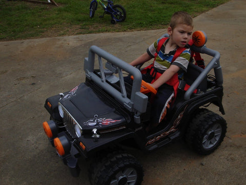 oliver in his power wheels jeep